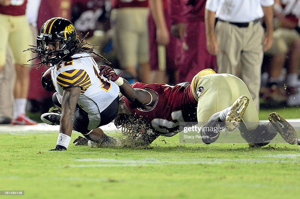 Preston Cleckley #12 of the Bethune-Cookman Wildcats is tackled by Telvin Smith #22 of the Florida State Seminoles during a game at Doak Campbell Stadium on September 21, 2013 in Tallahassee, Florida.
