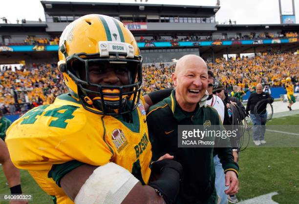 Preston Evans of North Dakota State University celebrates with head coach Craig Bohl after beating Sam Houston State 176 during the Division I Men's...