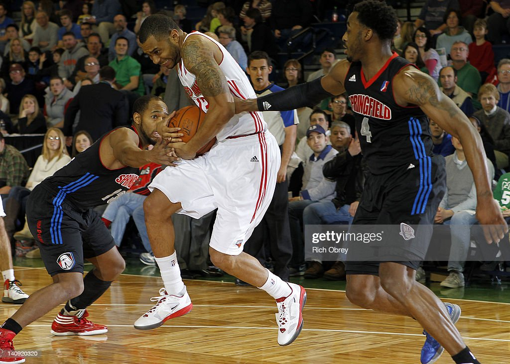 Preston Knowles (13) and L. D. Williams of the Springfield Armor team up to force a turnover by Xavier Silas (13) of the Maine Red Claws during the game on March 2, 2012 at the Portland Expo in Portland, Maine.
