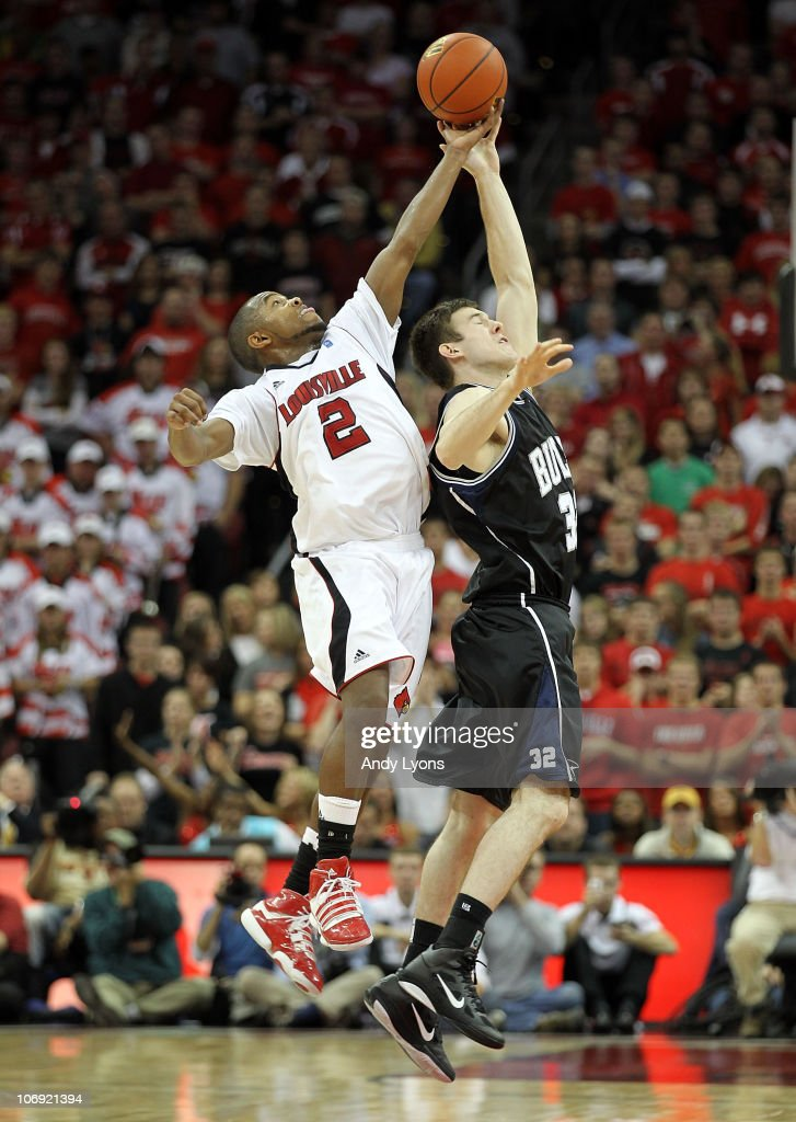 Preston Knowles #2 of the Louisville Cardinals and Garrett Butcher #32 of the Butler Bulldogs reach for a loose ball during the game at the KFC Yum! Center on November 16, 2010 in Louisville, Kentucky. Louisville won 88-73.
