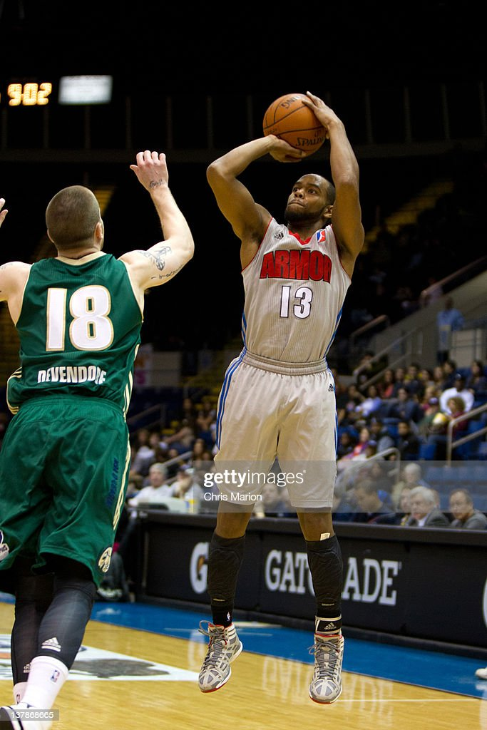 Preston Knowles #13 of the Springfield Armor shoots from outside defended by Eric Devendorf #18 of the Reno Bighorns at the MassMutual Center on January 28, 2012 in Springfield, Massachusetts.