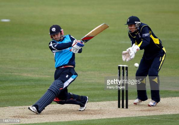 Preston Mommsen of Scotland hits out watched by Hampshire wicketkeeper Michael Bates during the Clydesdale Bank Pro40 match between the Hampshire...
