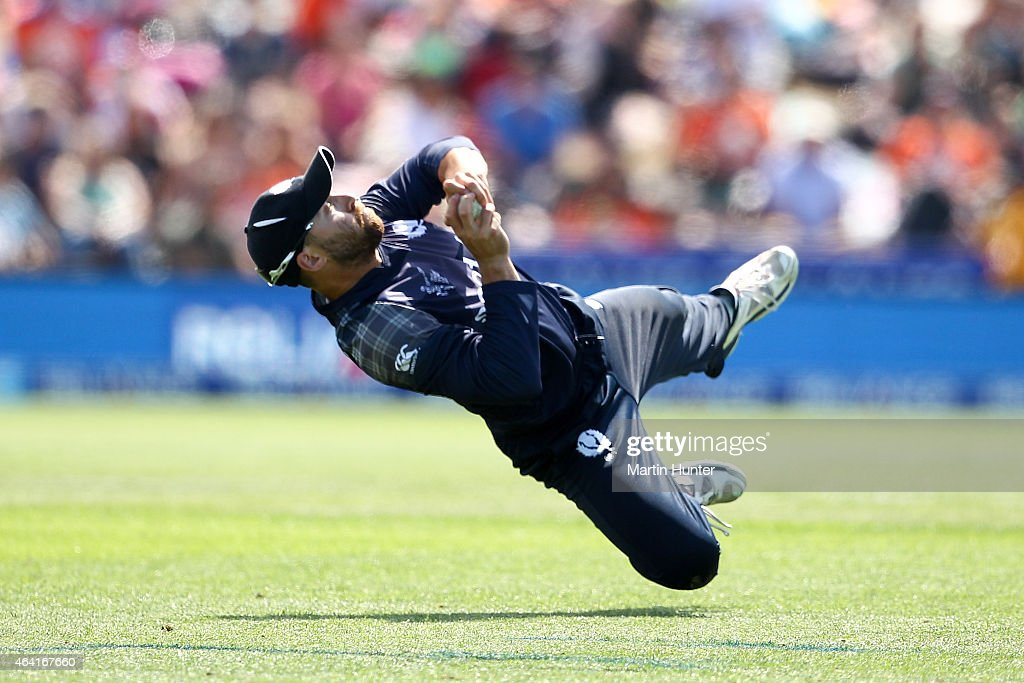 Preston Mommsen of Scotland holds a catch to dismiss Chris Woakes of England during the 2015 ICC Cricket World Cup match between England and Scotland...