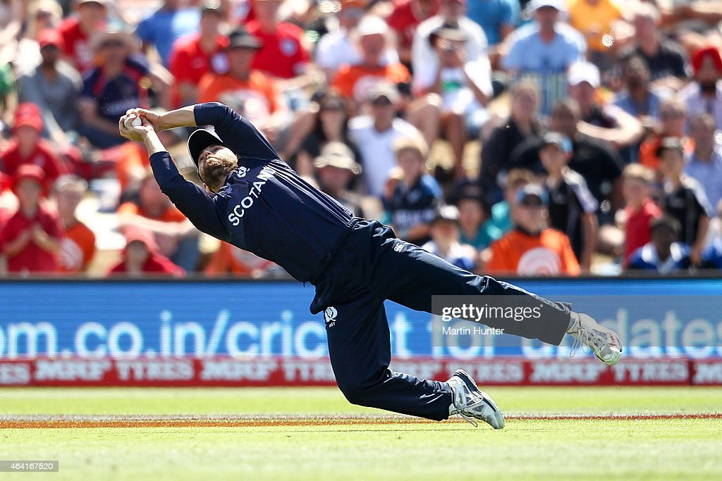 Preston Mommsen of Scotland holds a catch to dismiss Eoin Morgan of England during the 2015 ICC Cricket World Cup match between England and Scotland...