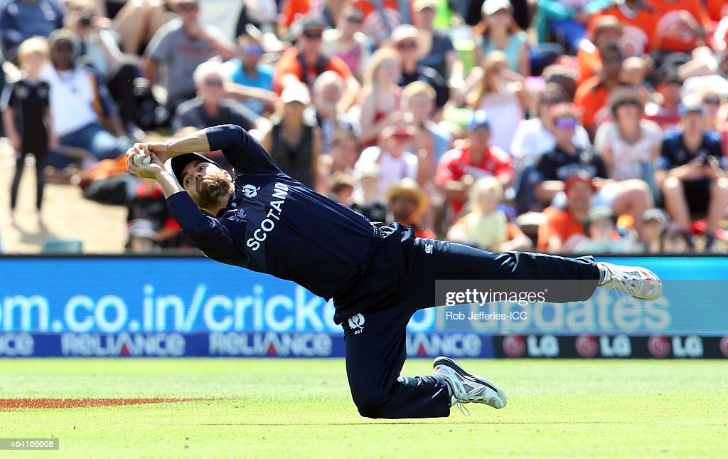 Preston Mommsen of Scotland takes a catch to dismiss Eoin Morgan of England off the bowling of Josh Davey during the 2015 ICC Cricket World Cup match...