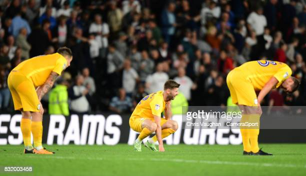 Preston North End players from left Jordan Hugill Paul Gallagher and Paul Huntington at the final whistle of the Sky Bet Championship match between...