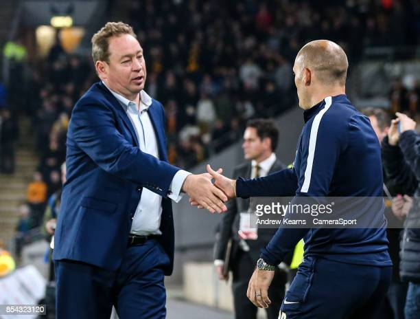 Preston North End's Alex Neil is greeted by Hull City's manager Leonid Slutsky during the Sky Bet Championship match between Hull City and Preston...