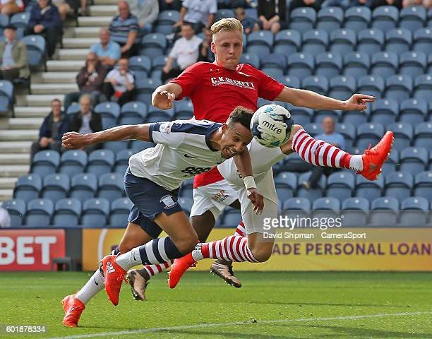 Preston North End's Callum Robinson gets his head to the ball before Barnsley's Angus MacDonald during the Sky Bet Championship match between Preston...