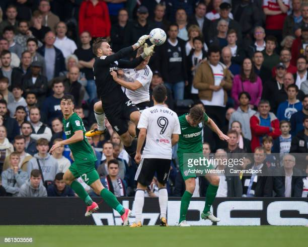 Preston North End's Chris Maxwell spills the ball under pressure leading to Fulham's Denis Odoi scoring his side's equalising goal to make the score...