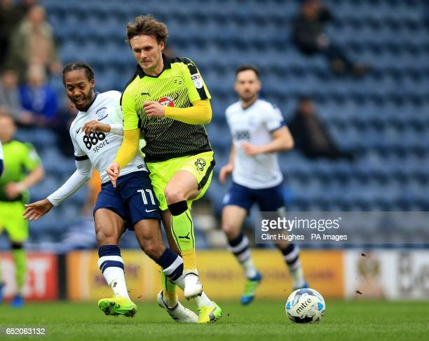 Preston North End's Daniel Johnson and Reading's John Swift battle for the ball during the Sky Bet Championship match at Deepdale Preston