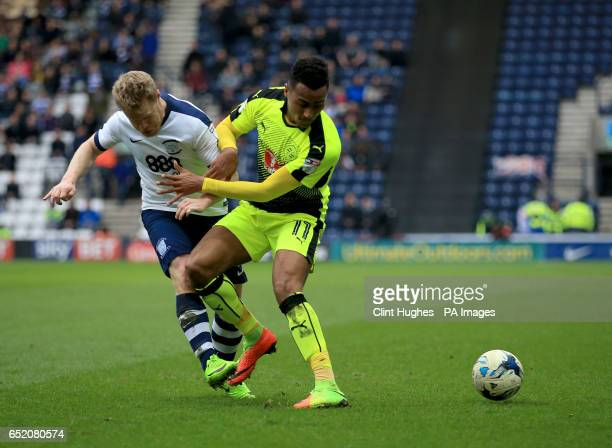 Preston North End's Daryl Horgan tackles Reading's Jordan Obita during the Sky Bet Championship match at Deepdale Preston