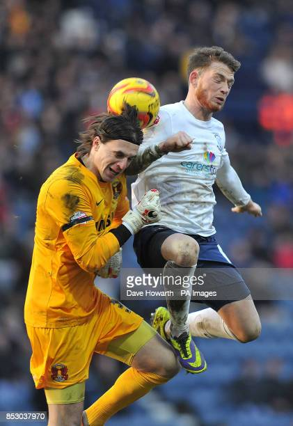 Preston North End's Joe Garner and Leyton Orient's Eldin Jakupovic battle for the ball during the Sky Bet League One match at Deepdale Preston