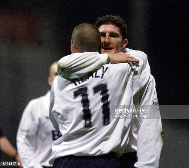 Preston North End's Jon Macken hugs David Healy while celebrating the 2nd goal during the Nationwide Division One match at Deepdale Preston THIS...