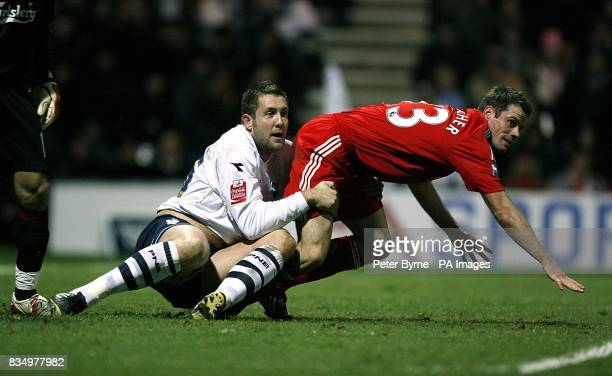 Preston North End's Jon Parkin pulls back Liverpool's Jamie Carragher a foul that disallowed Sean St Ledgers goal