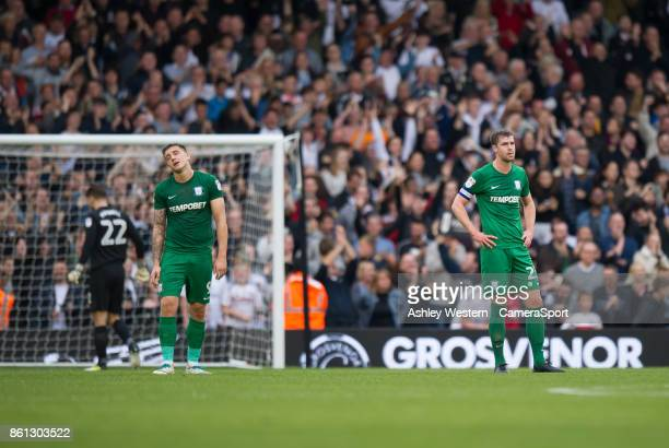 Preston North End's Jordan Hugill and Paul Huntington dejected as Fulham's Denis Odoi scores his side's equalising goal to make the score 22 during...