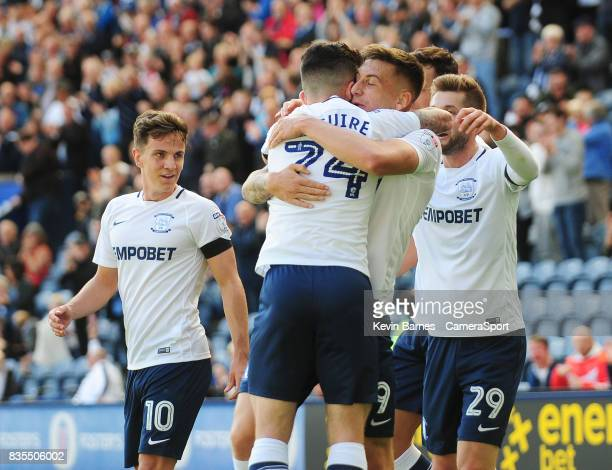 Preston North End's Jordan Hugill celebrates scoring the opening goal with teammate Sean Maguire during the Sky Bet Championship match between...