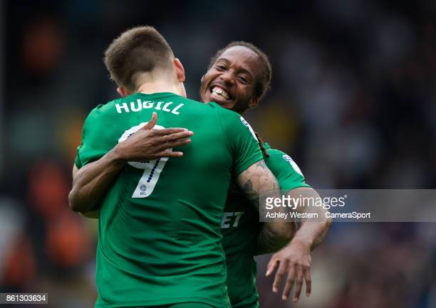 Preston North End's Jordan Hugill congratulated by Daniel Johnson after the first goal during the Sky Bet Championship match between Fulham and...