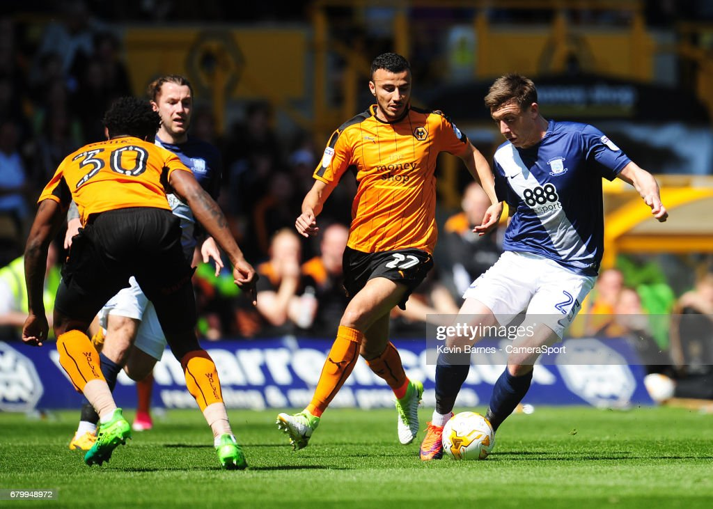 Preston North End's Jordan Hugill under pressure from Wolverhampton Wanderers' Romain Saiss during the Sky Bet Championship match between Wolverhampton Wanderers and Preston North End at Molineux on May 7, 2017 in Wolverhampton, England.