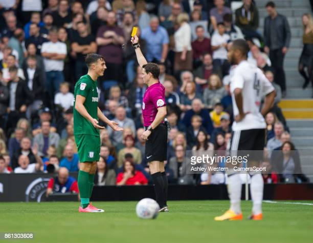 Preston North End's Josh Earl is shown a yellow card by Referee D England during the Sky Bet Championship match between Fulham and Preston North End...