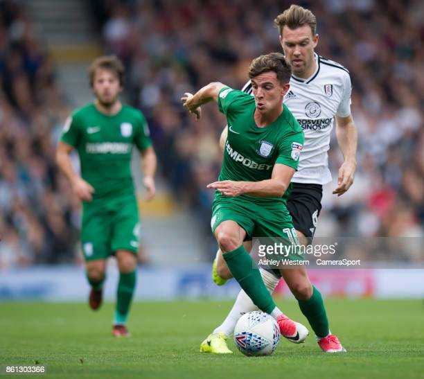 Preston North End's Josh Harrop holds off the challenge from Fulham's Kevin McDonald during the Sky Bet Championship match between Fulham and Preston...
