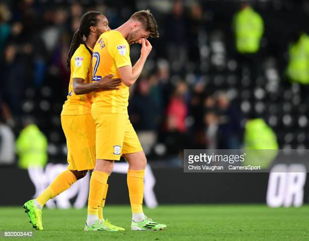 Preston North End's Paul Gallagher right is helped off the pitch by teammate Daniel Johnson after appearing to suffer an injury on the final whistle...