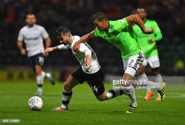 Preston North End's Sean Maguire battles with Cardiff City's Lee Peltier during the Sky Bet Championship match between Preston North End and Cardiff...