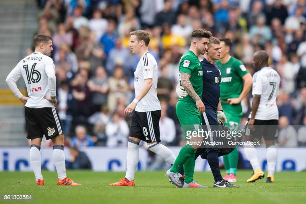 Preston North End's Sean Maguire leaves the pitch injured during the Sky Bet Championship match between Fulham and Preston North End at Craven...