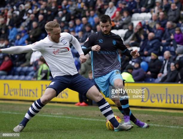 Preston North End's Tom Clarke tackles Sheffield Wednesday's Daniel Pudil