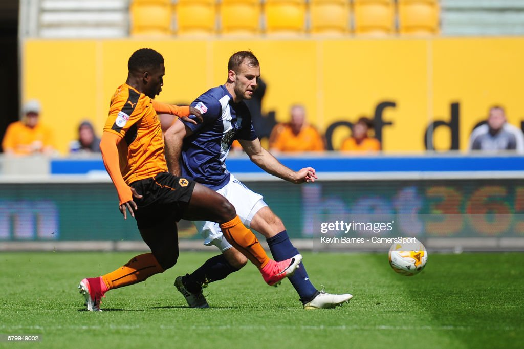 Preston North End's Tommy Spurr under pressure from Wolverhampton Wanderers' Nouha Dicko during the Sky Bet Championship match between Wolverhampton Wanderers and Preston North End at Molineux on May 7, 2017 in Wolverhampton, England.