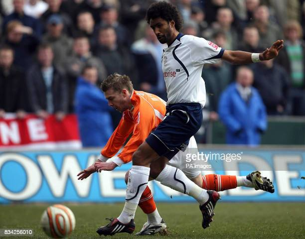 Preston North End's Youl Mawene and Blackpool's Stephen McPhee battle for the ball during the CocaCola Championship match at Bloomfield Road Blackpool