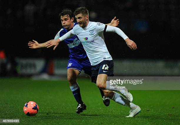 Preston player Paul Gallagher holds off Ipswich player Jay Tabb during the Budweiser FA Cup Third Round Replay between Preston North End and Ipswich...