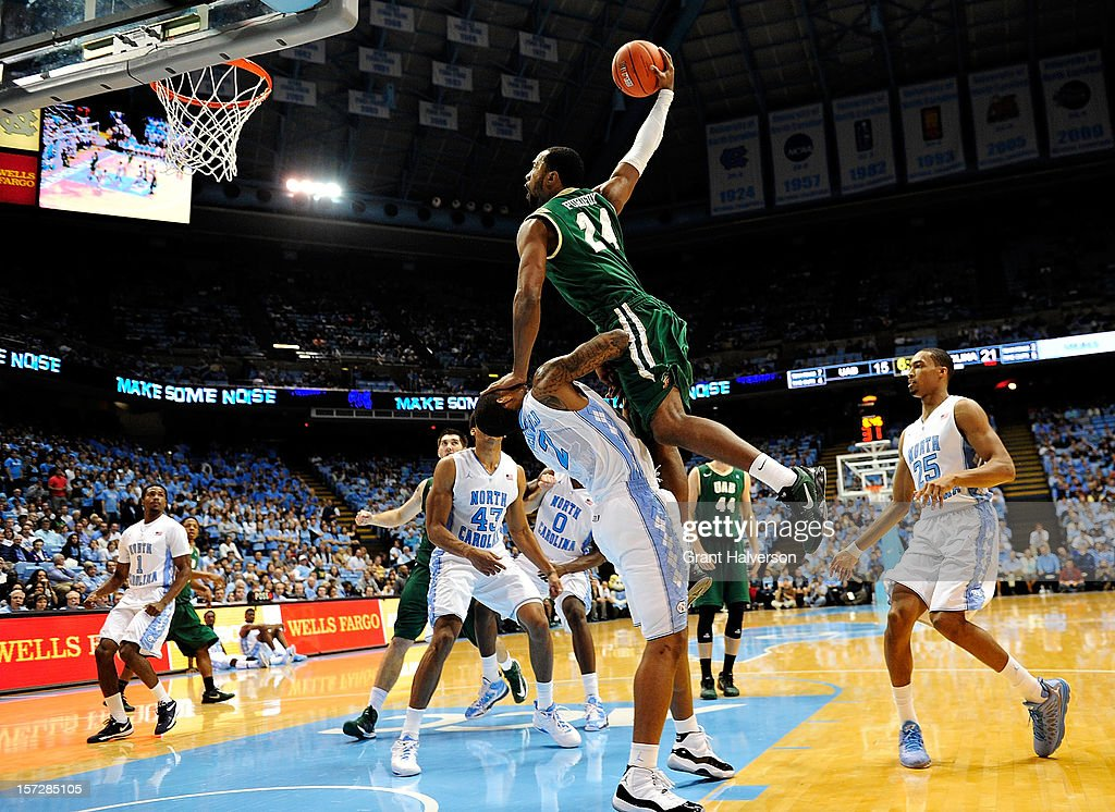Preston Purifoy #24 of the UAB Blazers draws a charging foul on a drive to the basket as he collides with Leslie McDonald #2 of the North Carolina Tar Heels during play at the Dean Smith Center on December 1, 2012 in Chapel Hill, North Carolina.