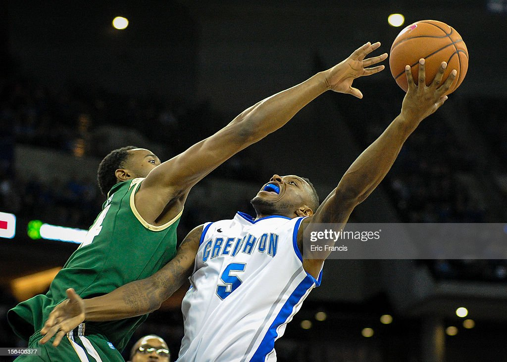 Preston Purifoy of the UAB Blazers tries to block the shot of Josh Jones of the Creighton Bluejays during their game at CenturyLink Center on...