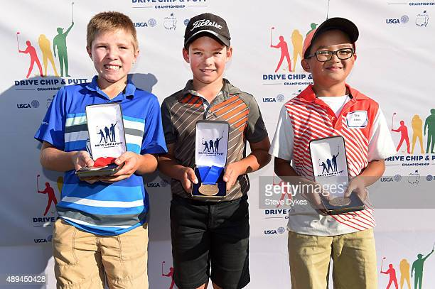 R Preston Slama Jackson Koivun and Eric Leonen pose with their medals after placing second first and third in the Drive competition in the Boys 1011...