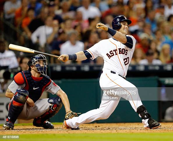 Preston Tucker of the Houston Astros hits a home run in the fifth inning as Blake Swihart of the Boston Red Sox watches the ball leave the park at...
