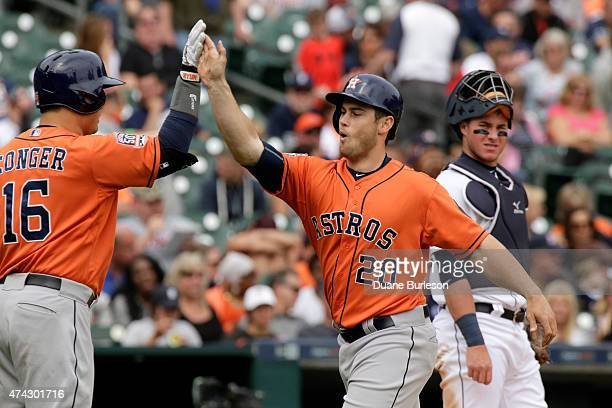 Preston Tucker of the Houston Astros is congratulated by Hank Conger of the Houston Astros after hitting his first major league home run to tie the...