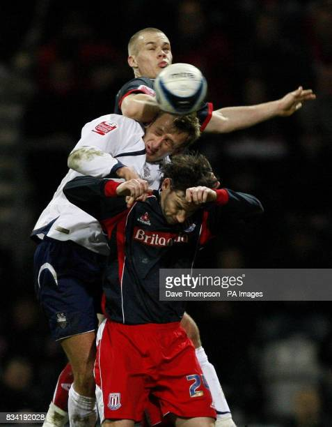 Preston's Chris Brown and Stoke's Ryan Shawcross and Rory Delap during the CocaCola Championship match at Deepdale Preston