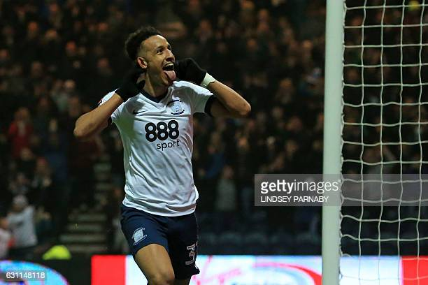 Preston's English striker Callum Robinson celebrates after scoring the opening goal of the English FA Cup third round football match between Preston...