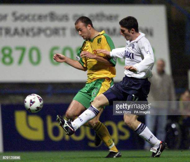 Preston's Jon Macken beats Norwich City's defender Brian McGovern to the ball during the Nationwide Division One game between Preston North End and...
