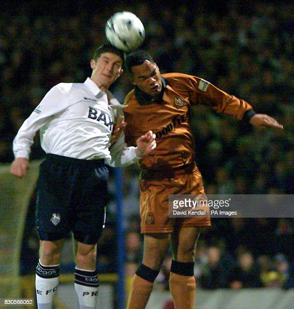Preston's Jon Macken jumps for the ball with Wolves Joleon Lescott during their Nationwide Division One match at Deepdale Preston