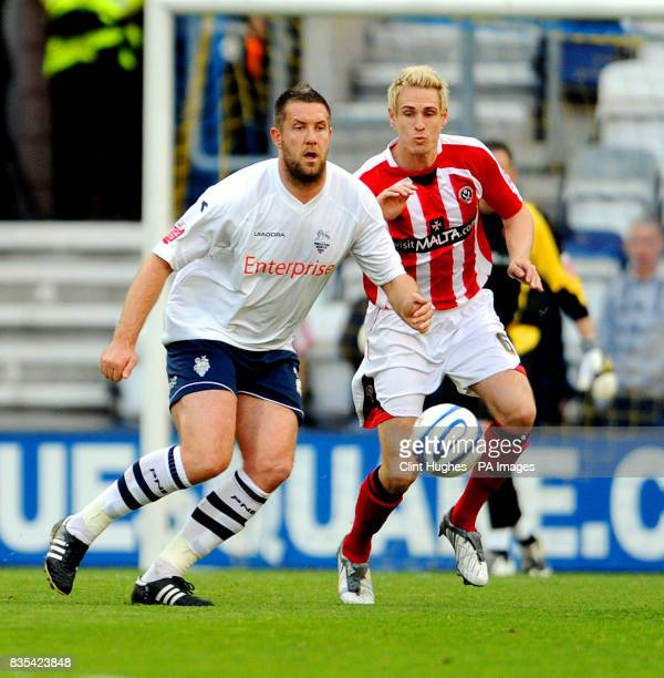 Preston's Jon Parkin battles for the ball with Sheffield United's Matthew Kilgallon during the CocaCola Championship Play Off Semi Final First Leg...