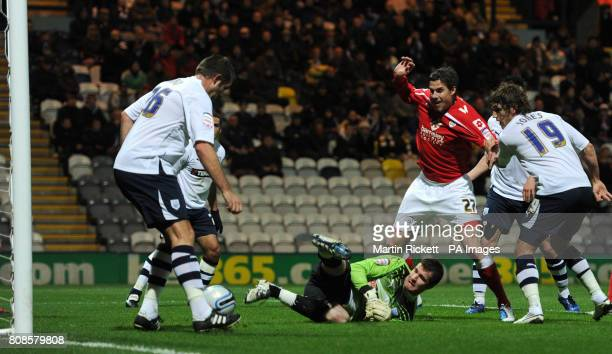 Prestons Jon Parkin clears the ball off the line after a shot from Barnsleys Andy Gray during the npower Championship match at Deepdale Preston