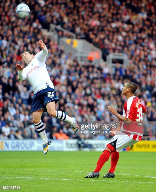 Preston's Ross Wallace heads the ball clear whilst Sheffield United's Kyle Naughton looks on during the CocaCola Championship Play Off Semi Final...