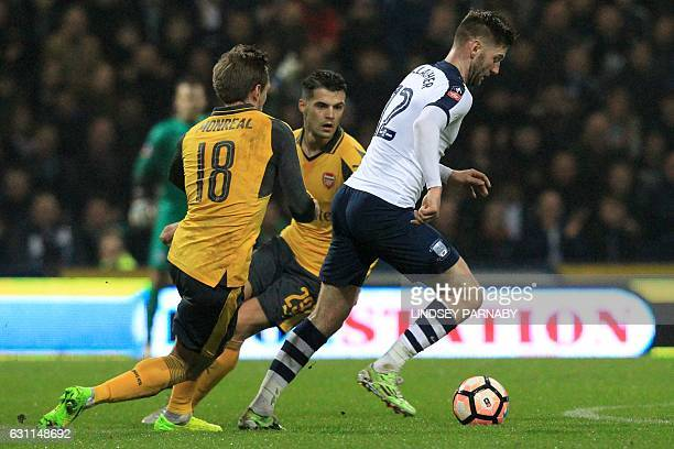 Preston's Scottish midfielder Paul Gallagher vies with Arsenal's Spanish defender Nacho Monreal during the English FA Cup third round football match...