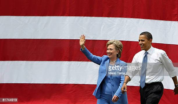 Presumptive Democratic presidential candidate Sen Barack Obama and former rival Sen Hillary Rodham Clinton wave to the crowd June 27 2008 in Unity...