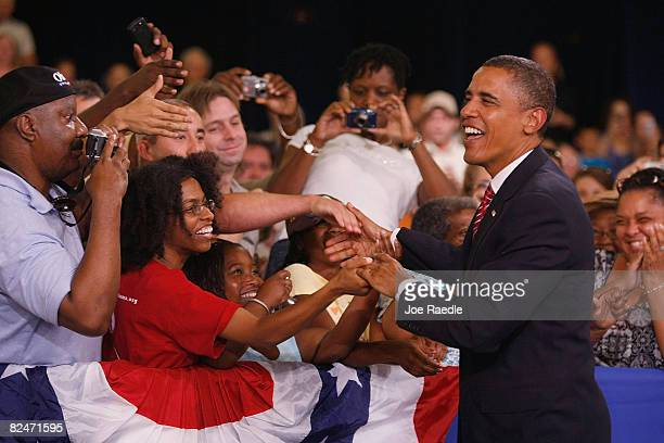 Presumptive Democratic Presidential candidate US Sen Barack Obama is greeted as he is introduced to speak during a campaign Town Hall event at the...