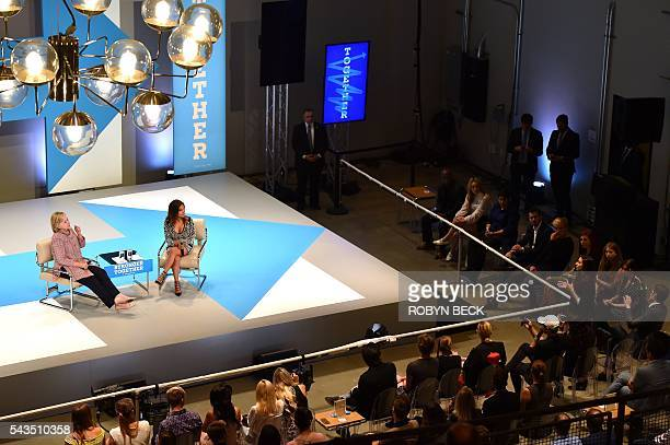 Presumptive Democratic presidential nominee Hillary Clinton and moderator Dulce Candy listen as YouTube celebrity Chrissy Chambers asks Clinton how...