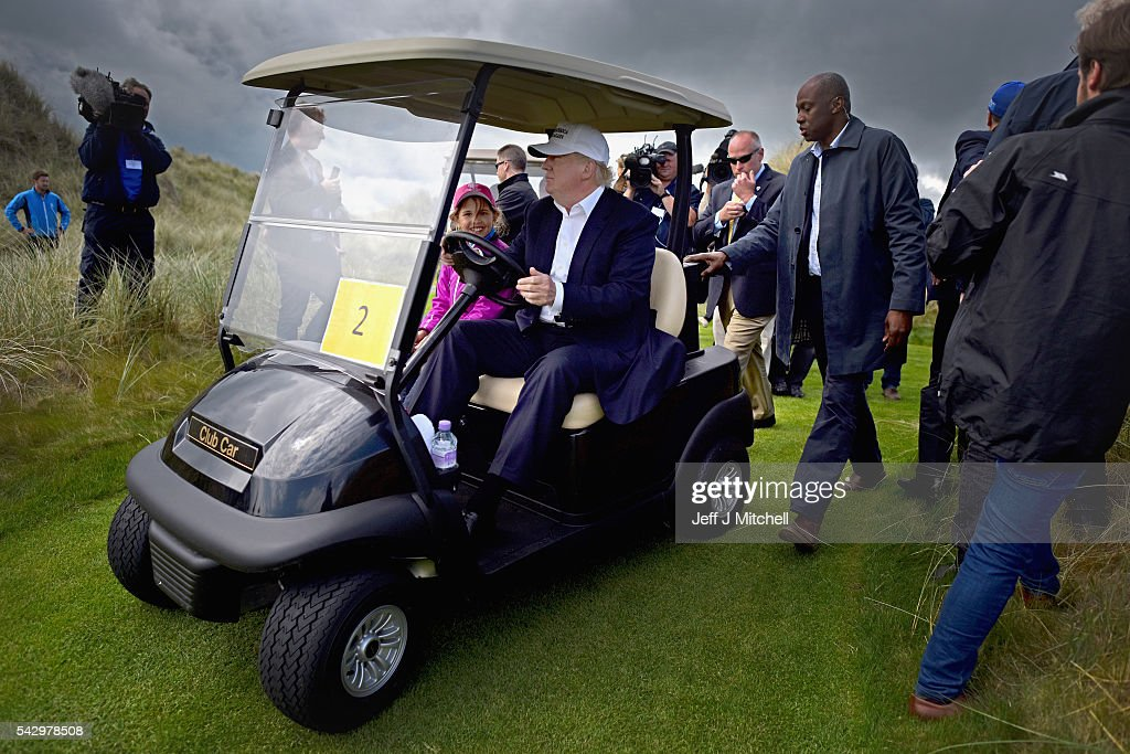 Presumptive Republican nominee for US president Donald Trump and his granddaughter Kai visit Trump International Golf Links on June 25, 2016 in Aberdeen, Scotland. The US presidential hopeful was in Scotland for the reopening of the refurbished Open venue golf resort Trump Turnberry which has undergone an eight month refurbishment as part of an investment thought to be worth in the region of two hundred million pounds.