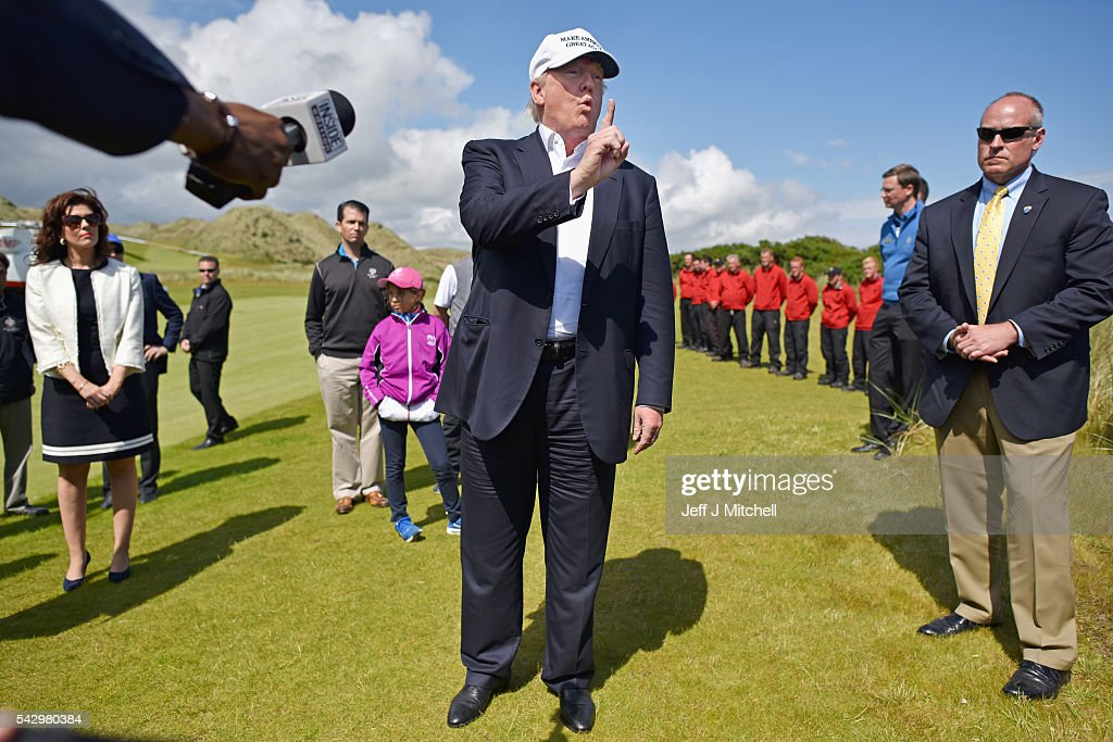 Presumptive Republican nominee for US president Donald Trump arrives at Trump International Golf Links on June 25, 2016 in Aberdeen, Scotland. The US presidential hopeful was in Scotland for the reopening of the refurbished Open venue golf resort Trump Turnberry which has undergone an eight month refurbishment as part of an investment thought to be worth in the region of two hundred million pounds.