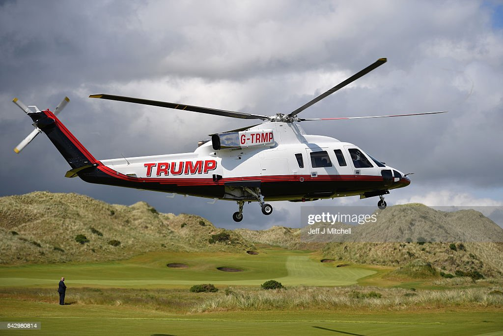 Presumptive Republican nominee for US president Donald Trump arrives in a helicopter at Trump International Golf Links on June 25, 2016 in Aberdeen, Scotland. The US presidential hopeful was in Scotland for the reopening of the refurbished Open venue golf resort Trump Turnberry which has undergone an eight month refurbishment as part of an investment thought to be worth in the region of two hundred million pounds.